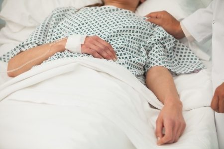 15590550 - old sick lady lying in hospital bed